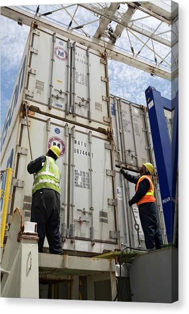 Hard Hat Canvas Print - Port Workers Handling Cargo Containers by Jim West