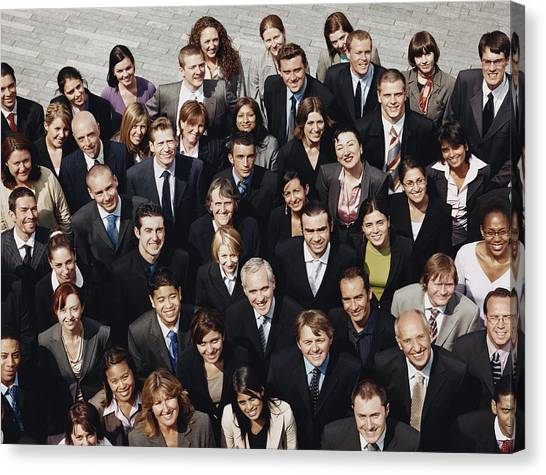 Portrait Of A Large Group Of Business People Standing Outdoors Canvas Print by Digital Vision.