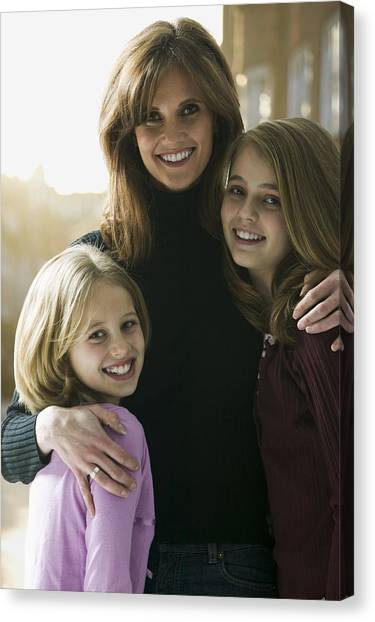 Portrait Of A Mid Adult Woman With Her Daughters Canvas Print by Photodisc