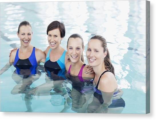 Portrait Of Smiling Women In Swimming Pool Canvas Print by Robert Daly