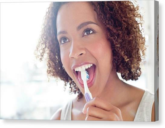 Toothbrush Canvas Print - Portrait Of Woman Brushing Tongue by Science Photo Library