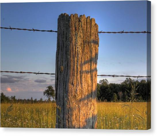 Post And Barb Wire Canvas Print