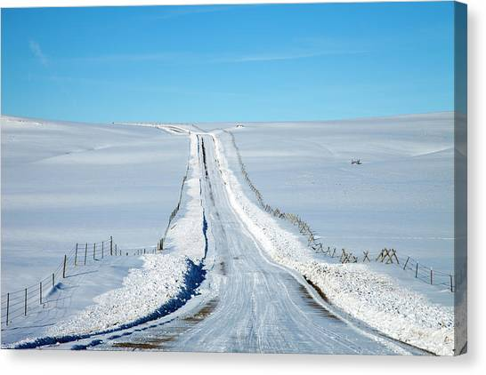 Pov Of Snow Covered Country Road Canvas Print by Andrew Geiger