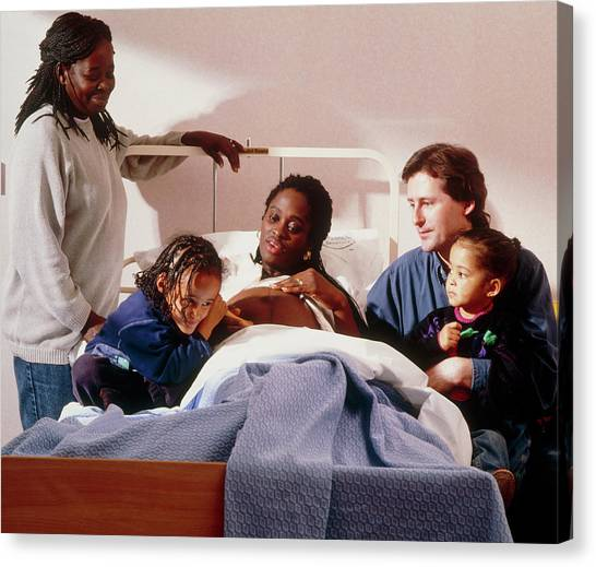 Pregnant Woman And Her Family On An Antenatal Ward Canvas Print by Ruth Jenkinson/midirs/science Photo Library