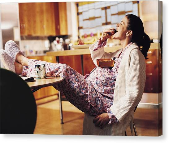 Pregnant Woman Eating Chocolate Canvas Print by Cohen/Ostrow