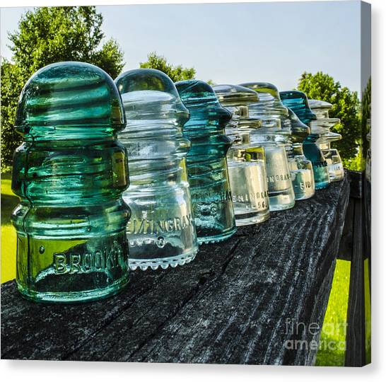 Pretty Glass Insulators All In A Row Canvas Print