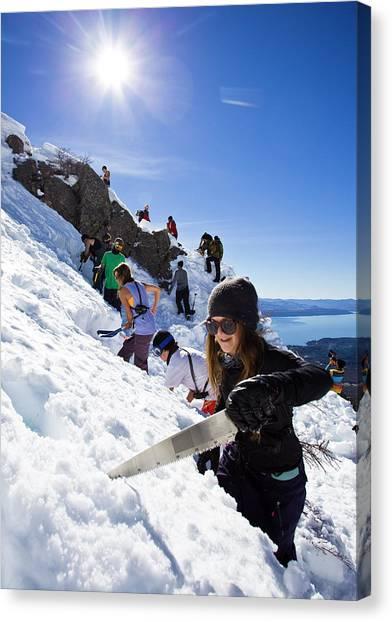 Shovels Canvas Print - Professional Skier Using A Snow Saw by Ben Girardi