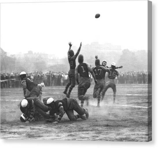 Football Teams Canvas Print - Quarterback Throwing Football by Underwood Archives