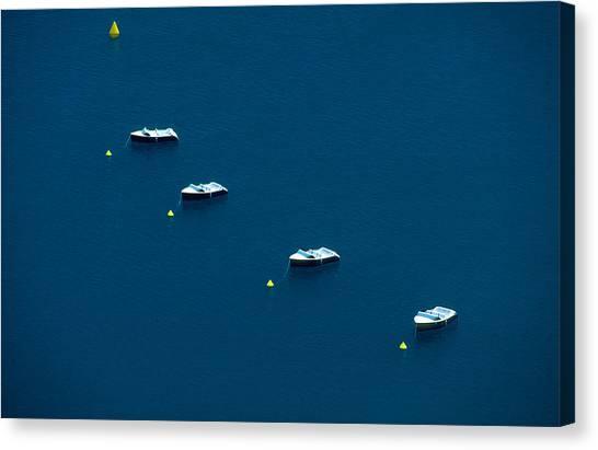 Quatre Petits Bateaux Canvas Print by Kim Lessel