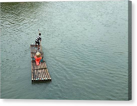 Raft In River Canvas Print