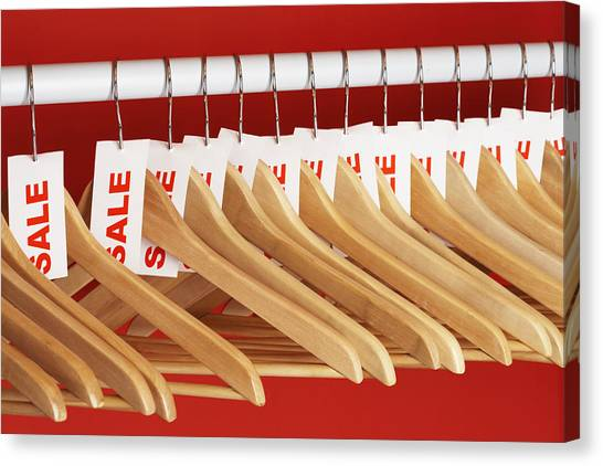 Rail Of Clothes Hangers With Sale Tags Attached, Close-up Canvas Print by Martin Poole