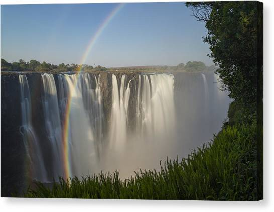 Victoria Falls Canvas Print - Rainbows In The Mist Of Victoria Falls by Vincent Grafhorst