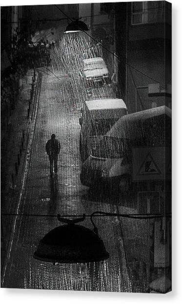 Wet Canvas Print - Rainy Man by Nihal Eken