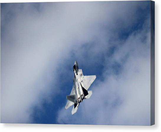Raptor In The Clouds Canvas Print