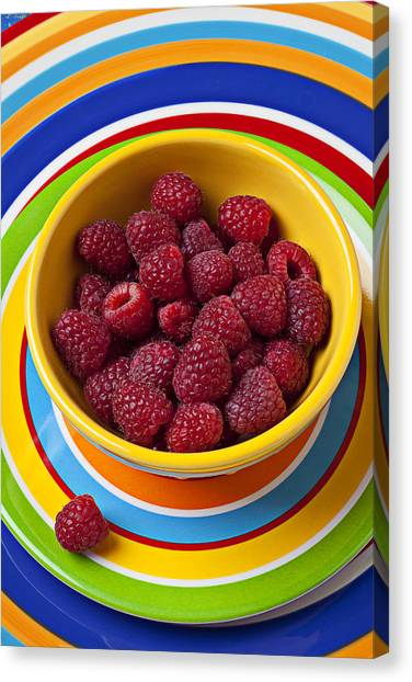 Raspberries Canvas Print - Raspberries In Yellow Bowl On Plate by Garry Gay