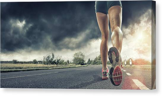 Rear View Of Runners Legs Canvas Print by Peepo