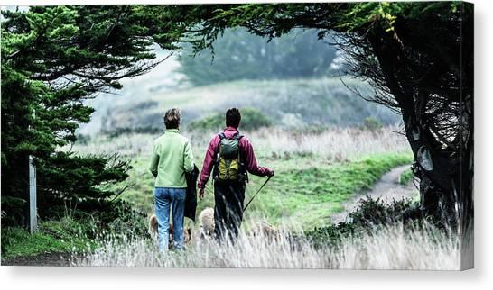 Backpacks Canvas Print - Rear View Of Two Women Walking by Ron Koeberer