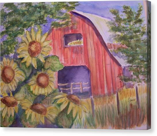 Red Barn With Sunflowers Canvas Print