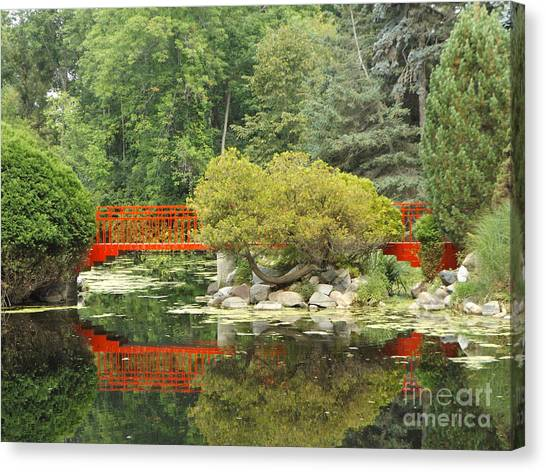 Red Bridge Reflection In A Pond Canvas Print