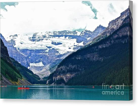 Red Canoes Turquoise Water Canvas Print