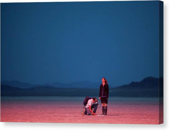 Black Rock Desert Canvas Print - Red Fireworks Glow Across The Desert by Michael Okimoto