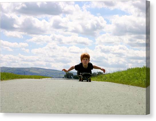 Red Headed Boy Skateboarding Canvas Print by Image by Catherine MacBride
