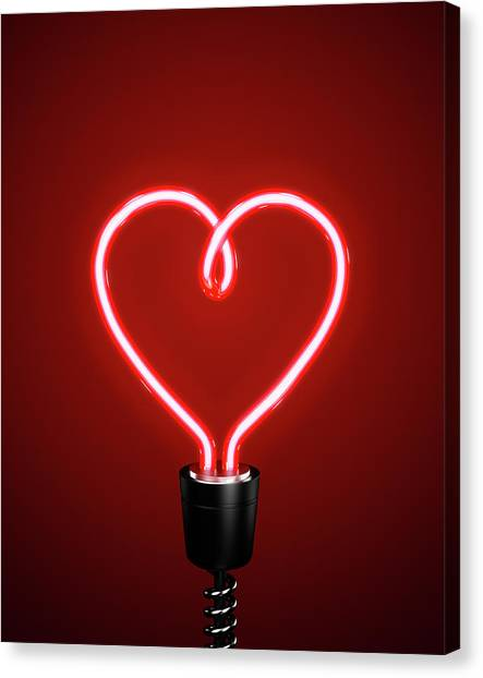 Red Heart Shaped Energy Saving Lightbulb Canvas Print by Atomic Imagery