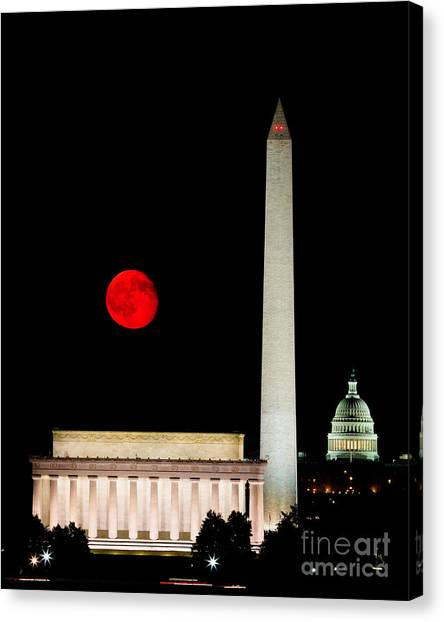 Red Moon Over Monuments Canvas Print