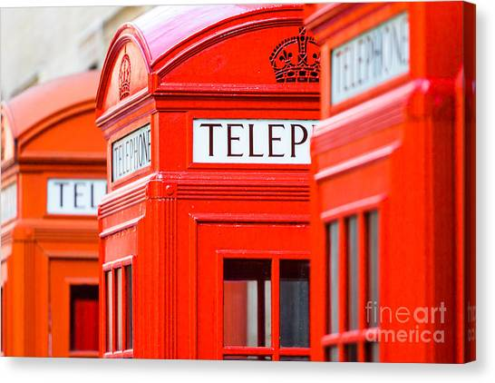Red Phone Boxes Canvas Print by Andy Myatt