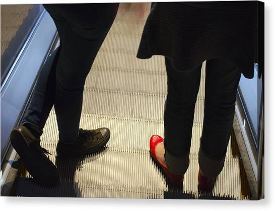 Red Shoe On Escalator Canvas Print