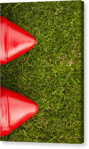 Red Shoes On Grass Canvas Print