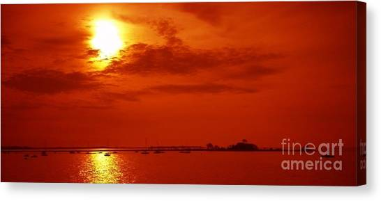Red Star Above The Sea Canvas Print by Jay Martin