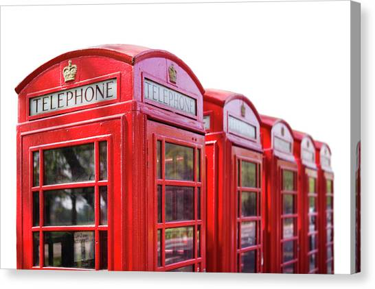 Red Telephone Boxes Against A White Canvas Print