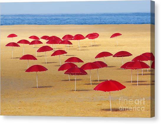 Beach Umbrellas Canvas Print - Red Umbrellas by Carlos Caetano