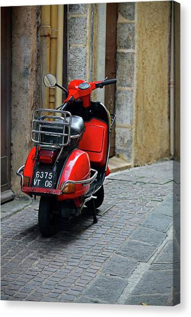 Red Vespa Scooter Parked In Sidestreet Canvas Print