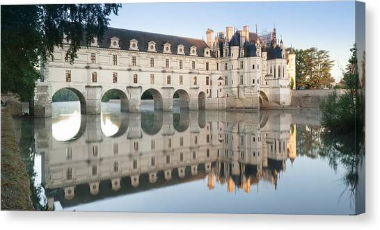 Chenonceau Castle Canvas Print - Reflection Of A Castle In A River by Panoramic Images