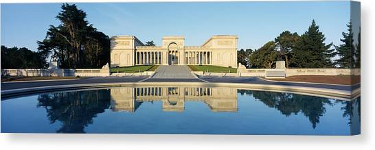 The Legion Canvas Print - Reflection Of A Palace In Water by Panoramic Images