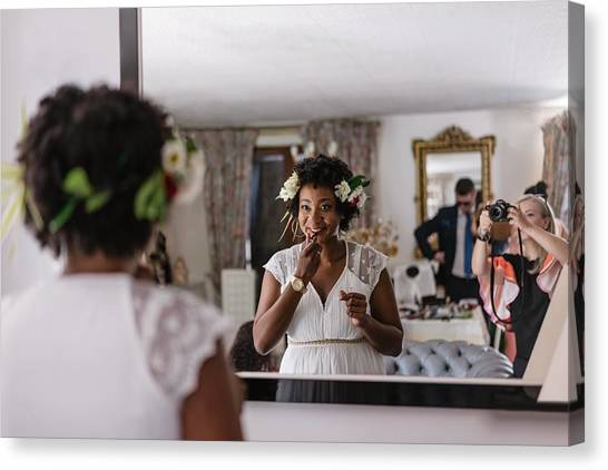 Reflection Of Bride Applying Lipstick While Standing In Front Of Mirror Canvas Print by Adriana Duduleanu / EyeEm