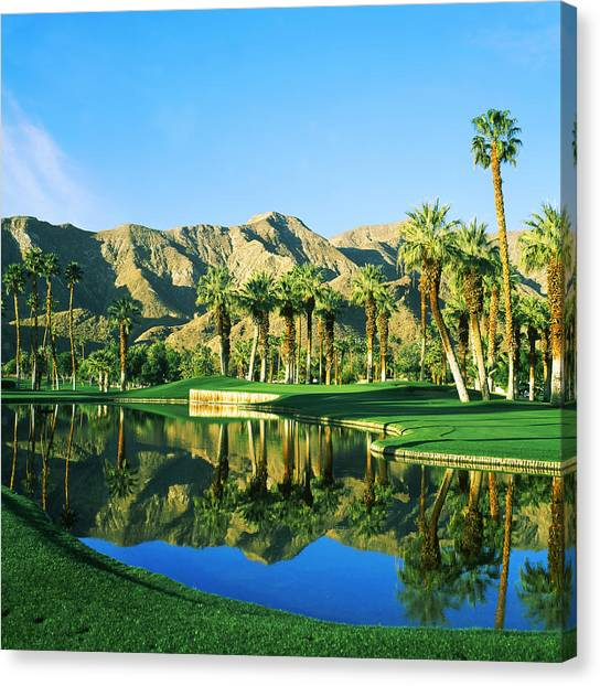 Golf Course Canvas Print - Reflection Of Trees On Water In A Golf by Panoramic Images