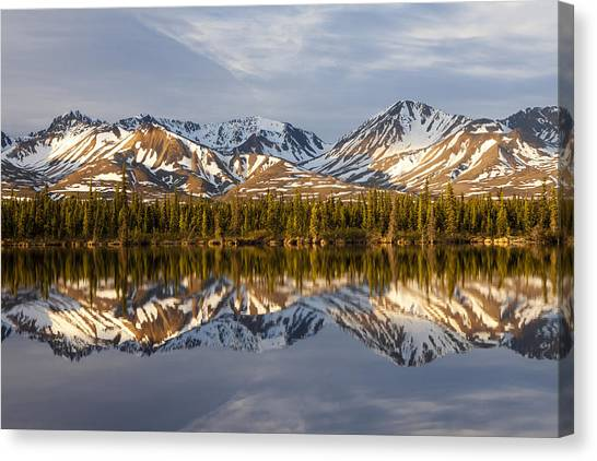 Reflections In Alaska Canvas Print by Javier Fores