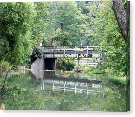 Reflections Of A Bridge Canvas Print by Adam L