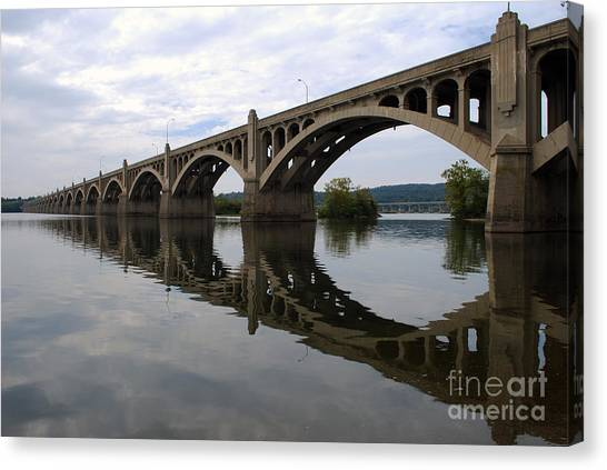 Reflections Of A Bridge Canvas Print