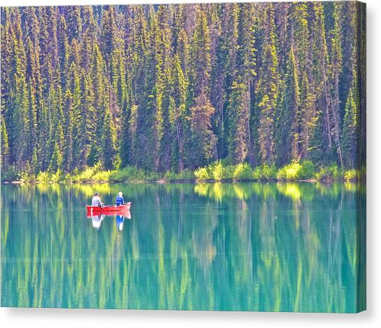 Reflective Fishing On Emerald Lake In Yoho National Park-british Columbia-canada  Canvas Print