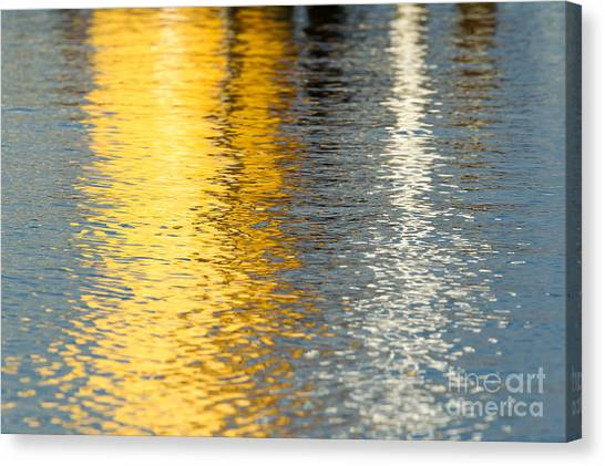 Reflective Water Colors Canvas Print by Kelly Morvant