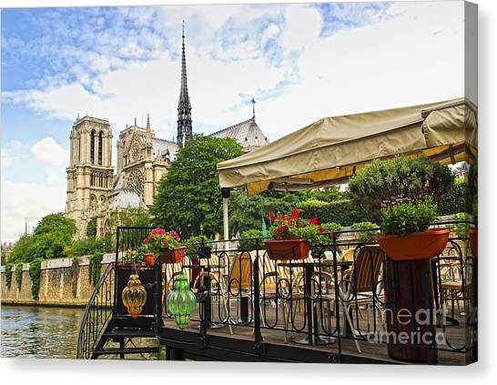 Notre Dame Canvas Print - Restaurant On Seine by Elena Elisseeva