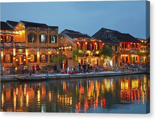 Restaurants Reflected In Thu Bon River Canvas Print by David Wall