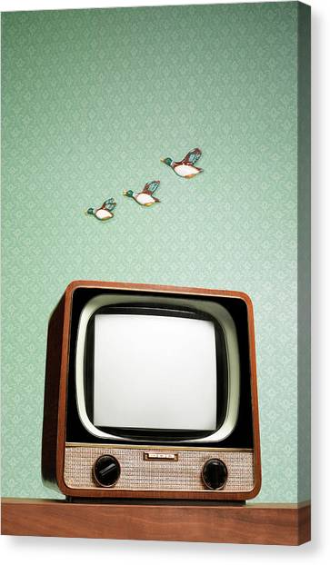 Retro Tv With Flying Ducks On The Wall Canvas Print