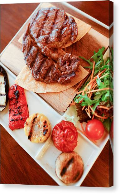 Ribeye Canvas Print - Ribeye Steak With Grilled Vegetables On A Plate by Anna Bryukhanova