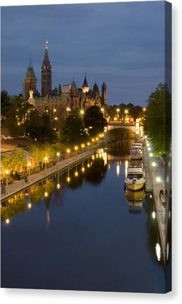 Rideau Canal And The Parliament Buildings At Night Canvas Print by Rob Huntley