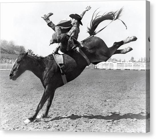 Bareback Canvas Print - Riding A Bucking Bronco by Underwood Archives
